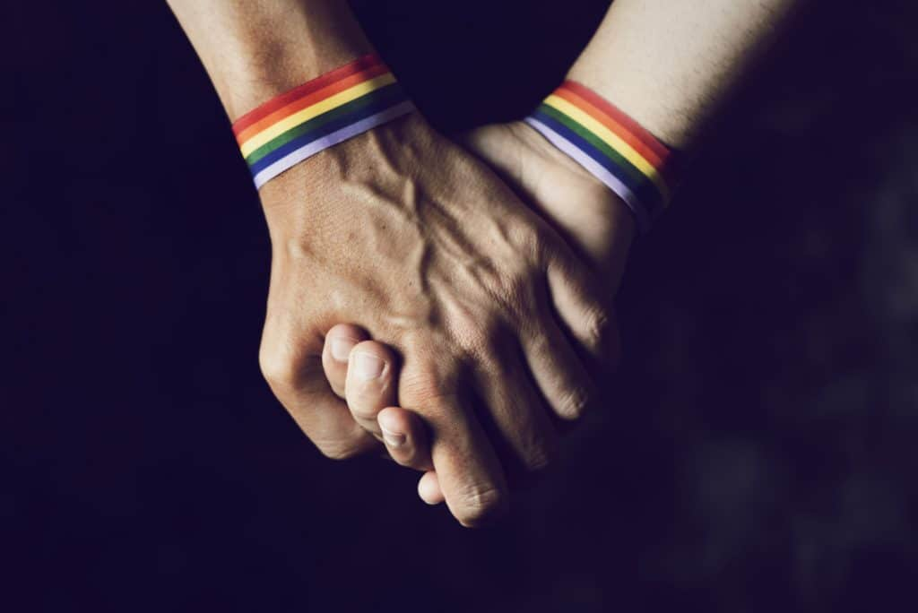 LBGTQ bands on hands